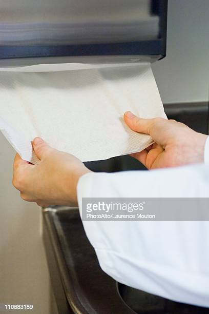 Taking paper towel from dispenser