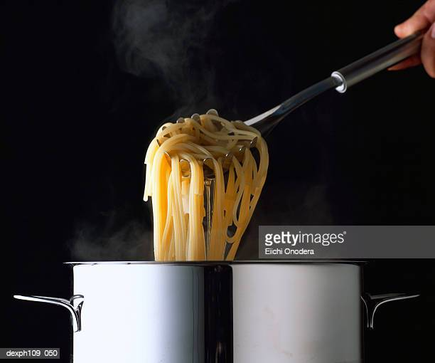 Taking Pasta from Pot