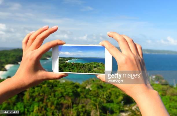 Taking photo of Boracay scenary on Luho Mountain