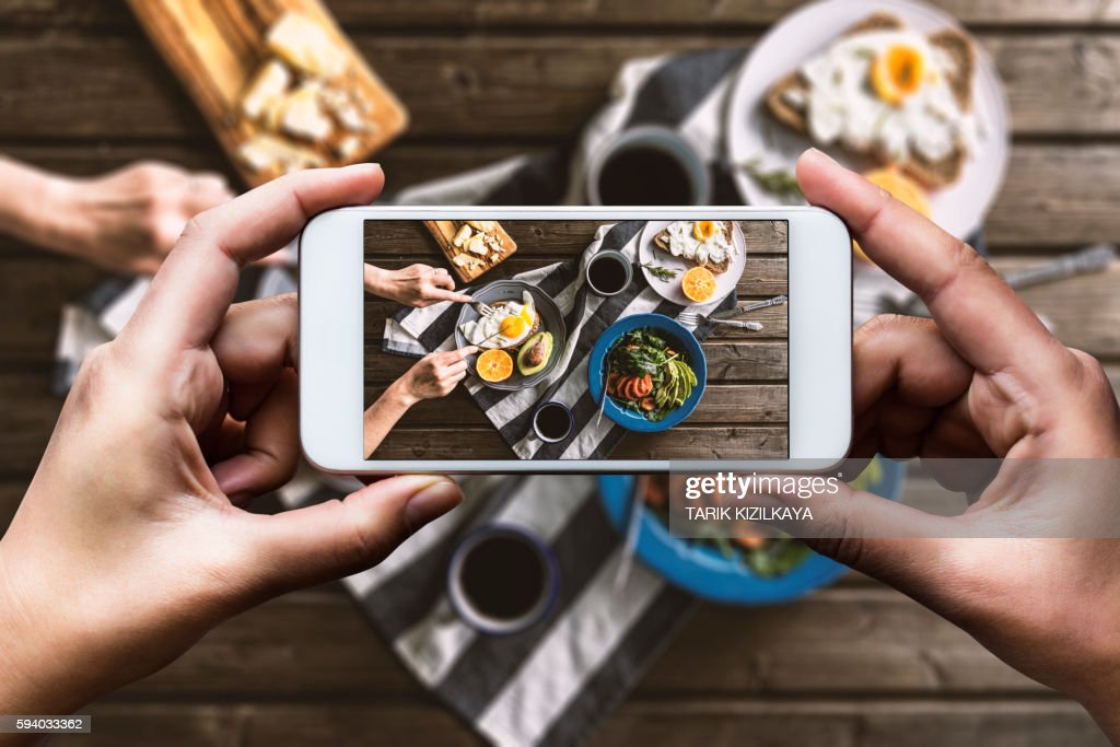 Taking photo of breakfast table : Stock Photo
