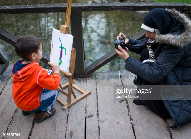 Taking photo of little artist