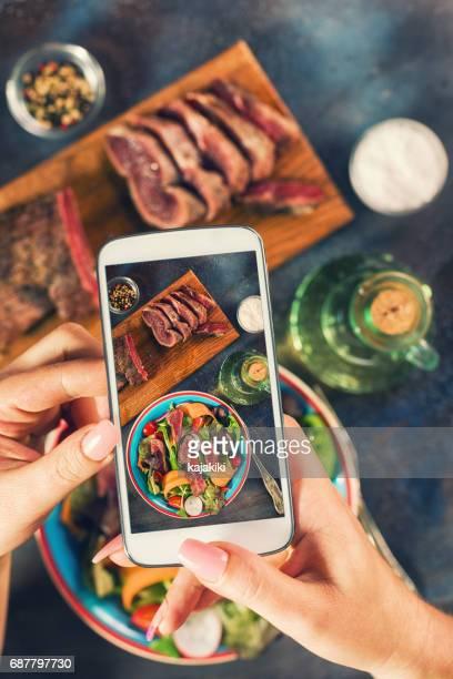Taking Photo of Spicy Beef Steak Salad
