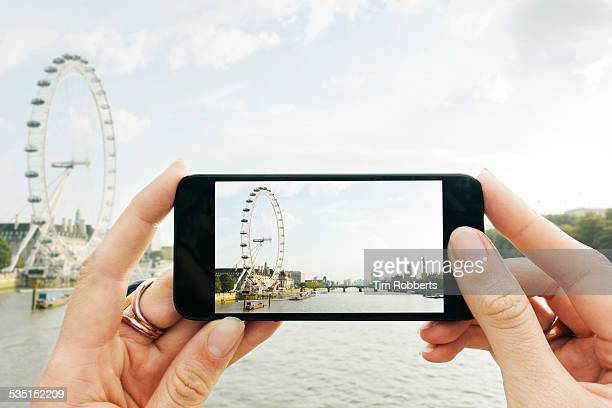 pov taking photo on smart phone. - photographing stock pictures, royalty-free photos & images