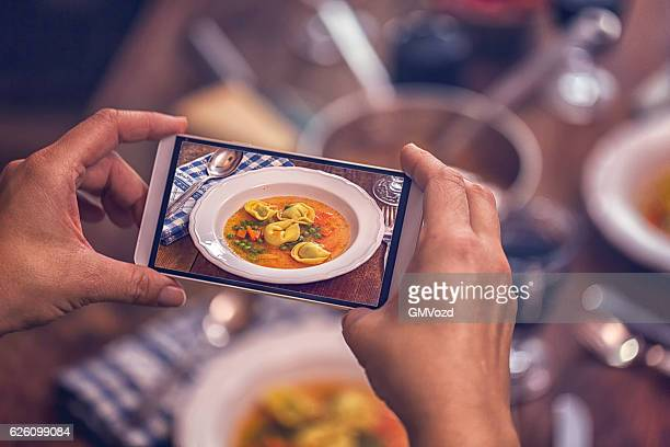 Taking Photo with Smartphone of Tortellini Soup
