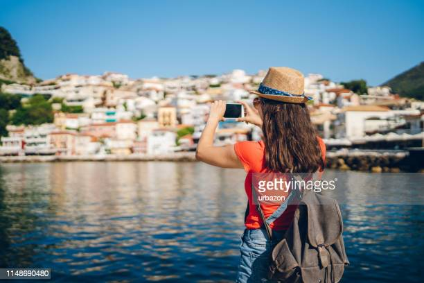 taking photos of greek coastal town - epirus greece stock pictures, royalty-free photos & images