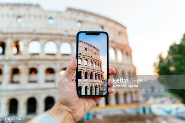 taking picture of coliseum using smart phone, personal perspective view - colosseum stock pictures, royalty-free photos & images