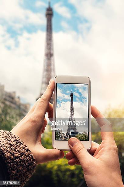 taking picture of eiffel tower - photography themes stock pictures, royalty-free photos & images