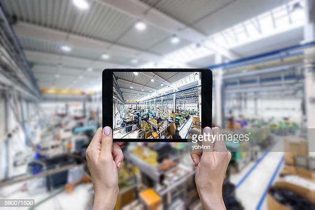 Taking picture of factory on a tablet