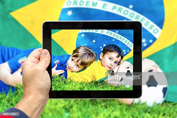 taking picture of two little soccer fans - pjphoto69 stock pictures, royalty-free photos & images