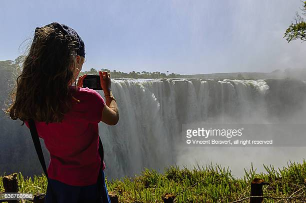 Taking picture of Victoria falls