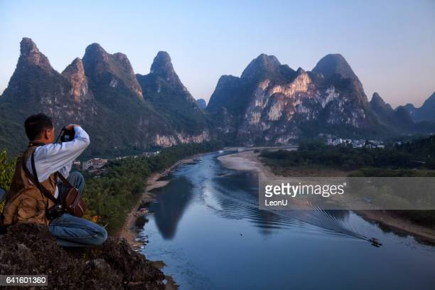 Taking picture on Li river in sunset, Guilin, China