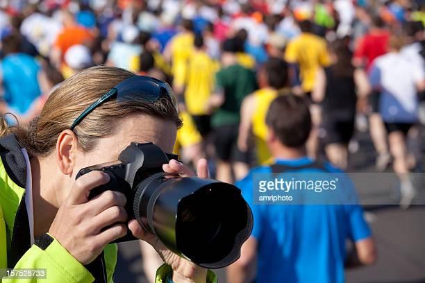 taking pictures at marathon