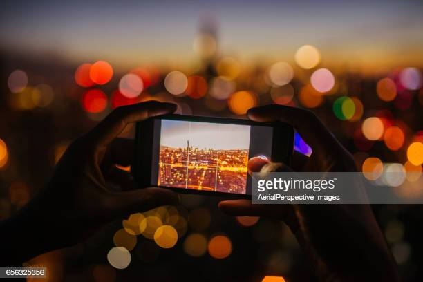 Taking pictures from personal point of view with smartphone of the Beijing Urban Skyline