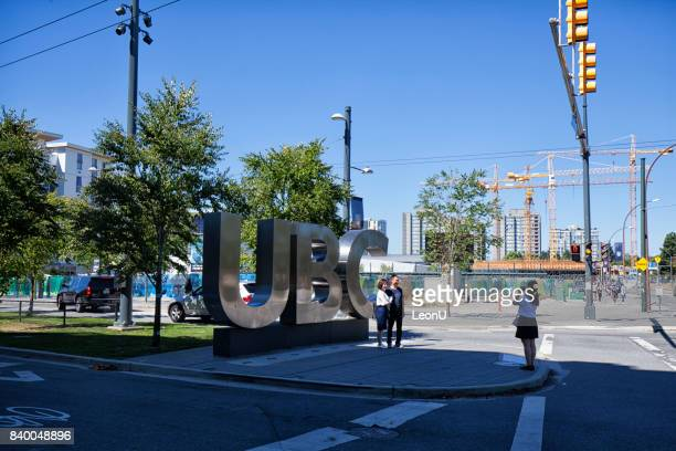 taking pictures in front of ubc sign, vancouver, canada - ubc stock pictures, royalty-free photos & images