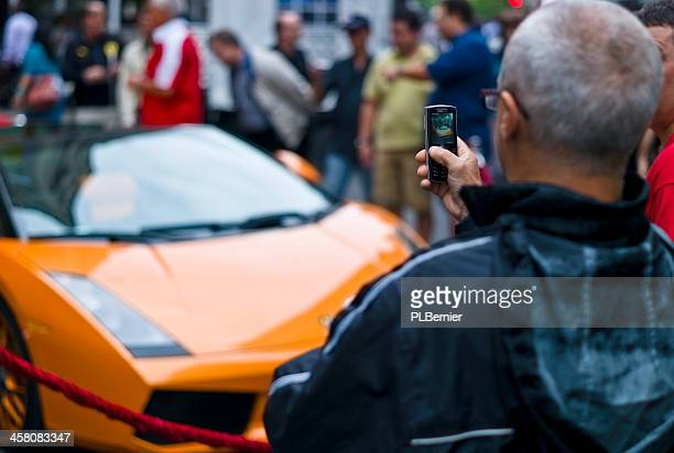 Taking pictures of a 2006 orange Lamborghini Gallardo Spyder