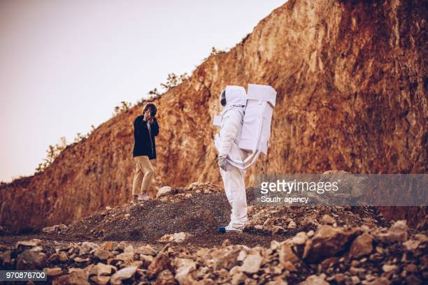 taking pictures on mars - space suit stock pictures, royalty-free photos & images