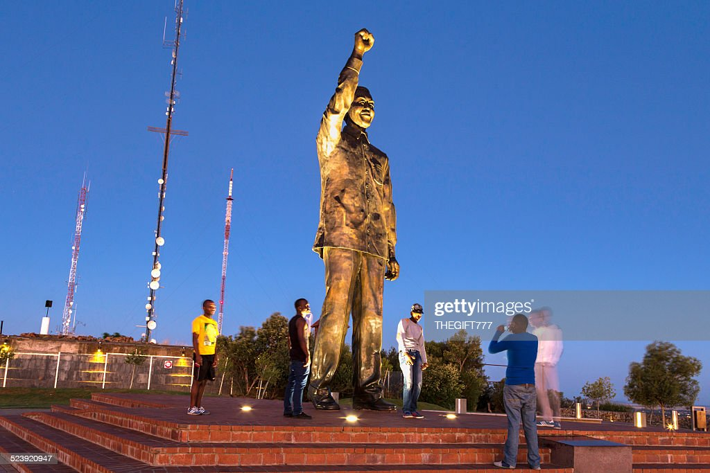 Taking pictures with Nelson Mandela statue in Bloemfontein : Stock Photo