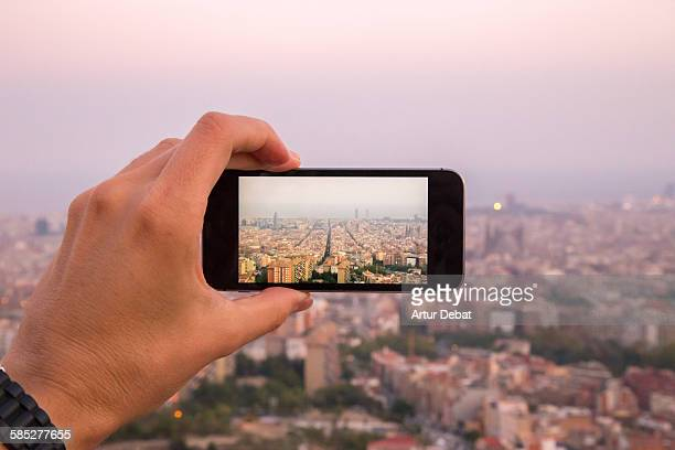 Taking pictures with smartphone of Barcelona city