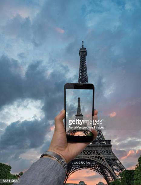 Taking pictures with smartphone of Eiffel Tower, Paris, France