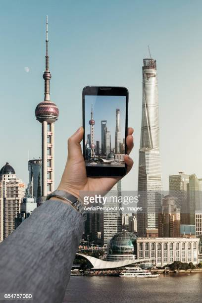 Taking pictures with smartphone of Shanghai Cityscape