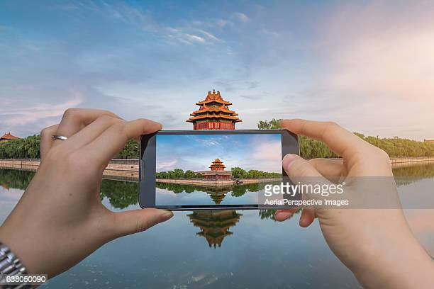 Taking pictures with smartphone of the Forbidden City, Beijing