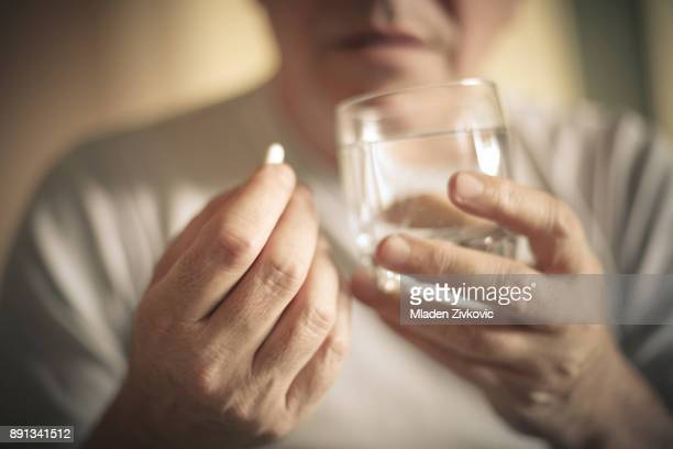 taking pill. - pill stock pictures, royalty-free photos & images
