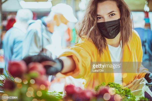 taking radishes - retail place stock pictures, royalty-free photos & images