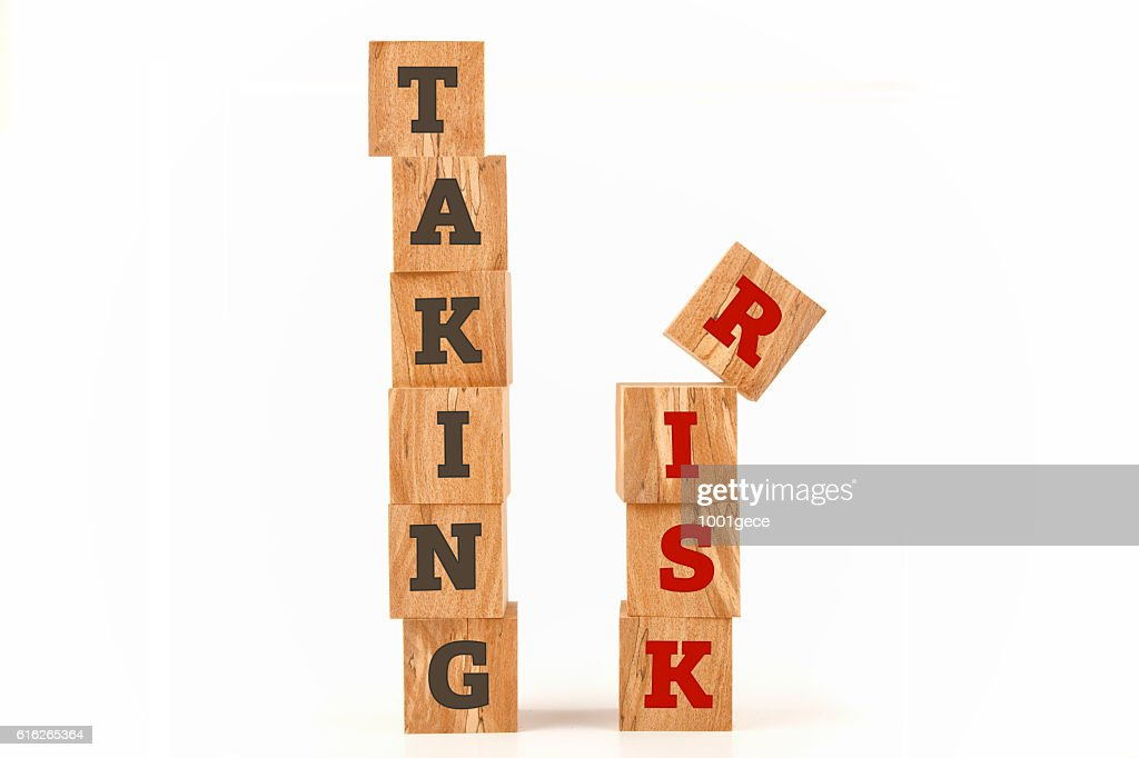 Taking Risk word written on cube shape : Stock Photo