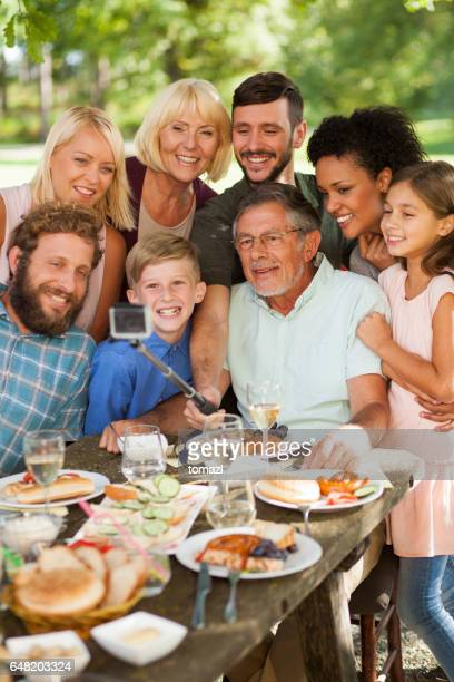 taking selfie at a family picnic - large family stock photos and pictures