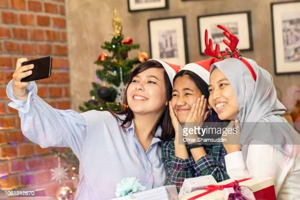 Taking selfie during Christmas party with friends at home