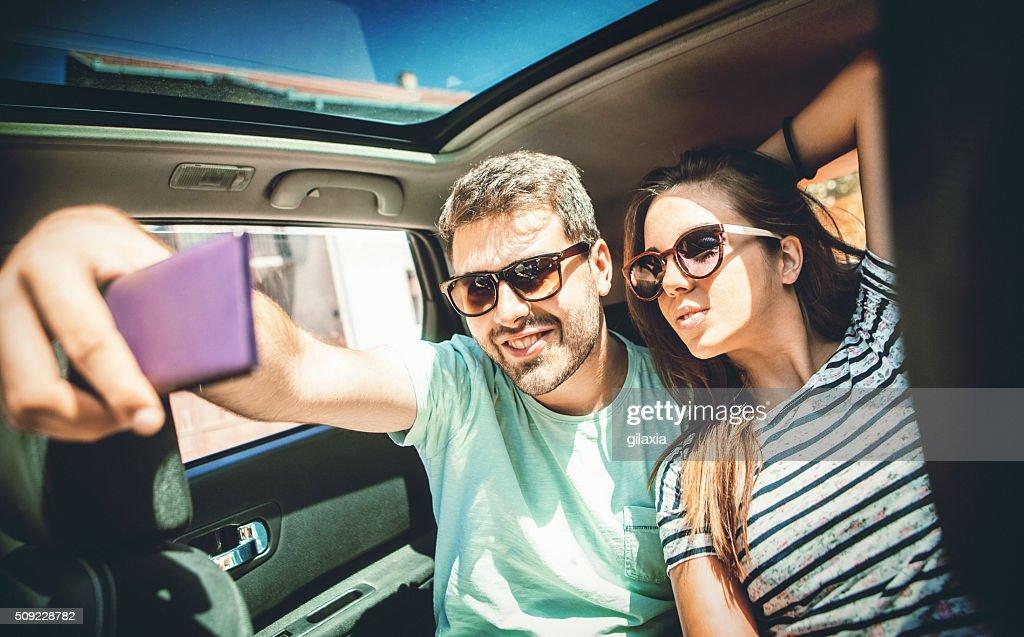 Taking selfie in a car. : Stock Photo