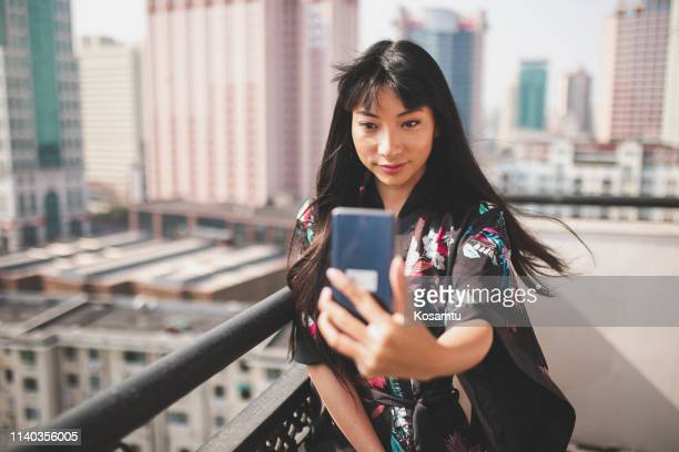 taking selfie on balcony - vanity stock pictures, royalty-free photos & images