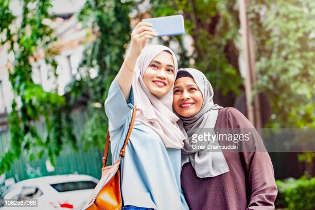 Taking selfie with mother after shopping in city centre