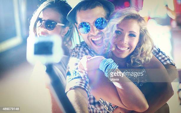 Taking selfies at concert.