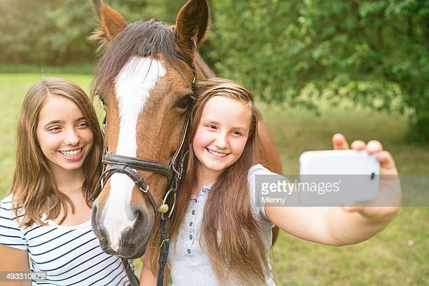 taking selfies girls mobile phone self portrait with horse - mlenny photography stock pictures, royalty-free photos & images