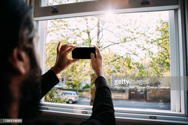 taking selfies / photos with a mobile phone - males stock pictures, royalty-free photos & images