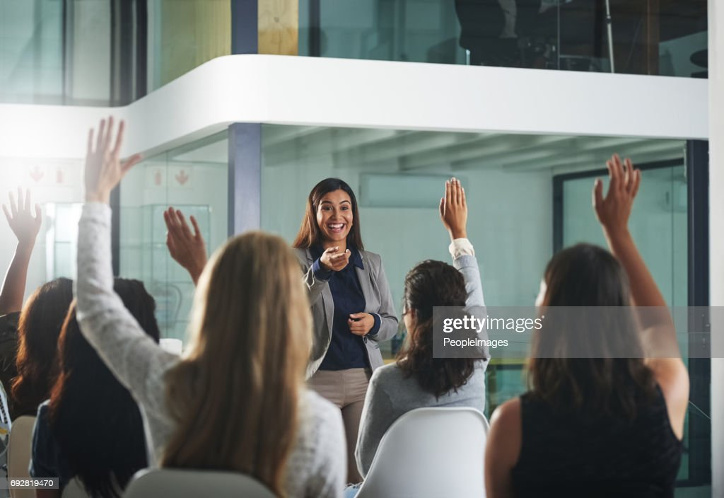 Taking some questions from the audience : Stock Photo