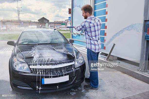 taking some time to care for the car. debica, poland - car wash brush stock photos and pictures
