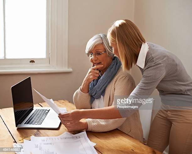 taking some time to help her grandmother - grandma invoice stock pictures, royalty-free photos & images