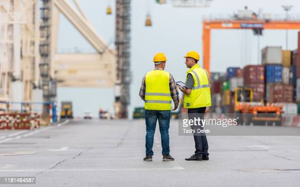taking stock of the shipyard - shipyard stock pictures, royalty-free photos & images