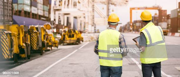 taking stock of the shipyard - dock worker stock photos and pictures
