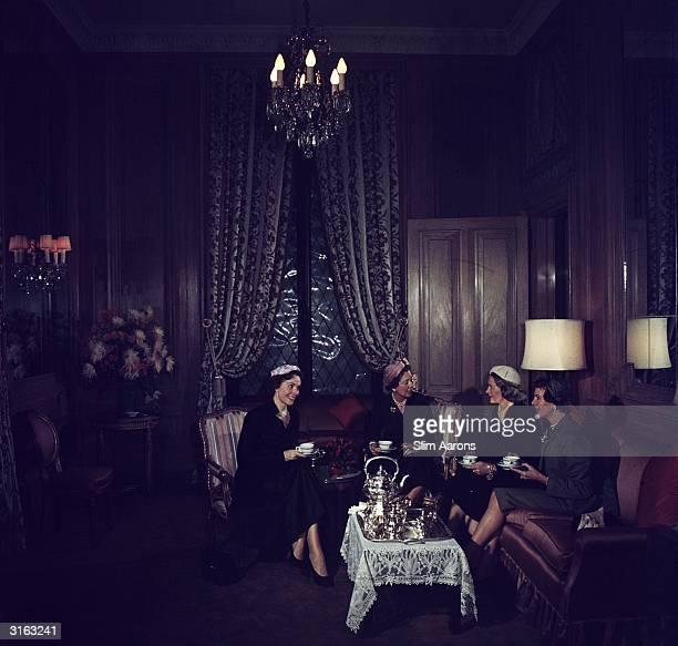 Taking tea at the St Regis Hotel New York from l to r Baroness Daubeck Mrs Frederick B Payne Mrs Vincent Astor and Mrs Cornelius Vanderbilt Whitney