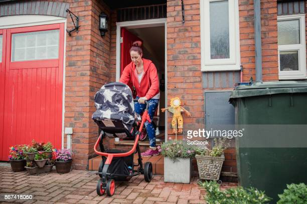 taking the baby for a run - single mother stock photos and pictures