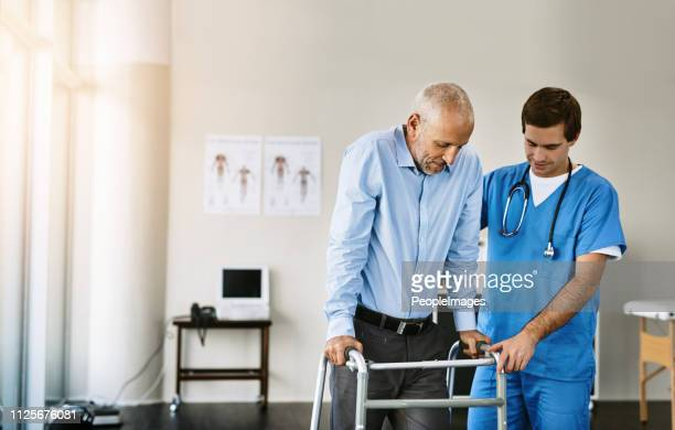 taking the first step towards recovery - male nurse stock pictures, royalty-free photos & images