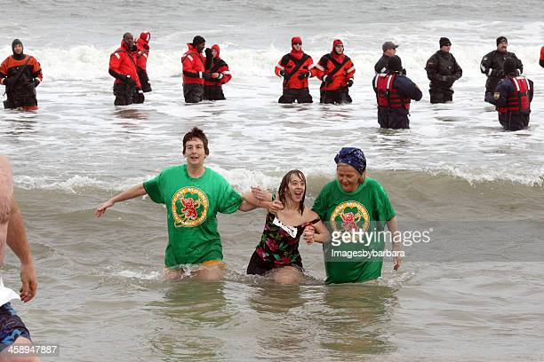 taking the polar plunge - polar bear plunge stock pictures, royalty-free photos & images