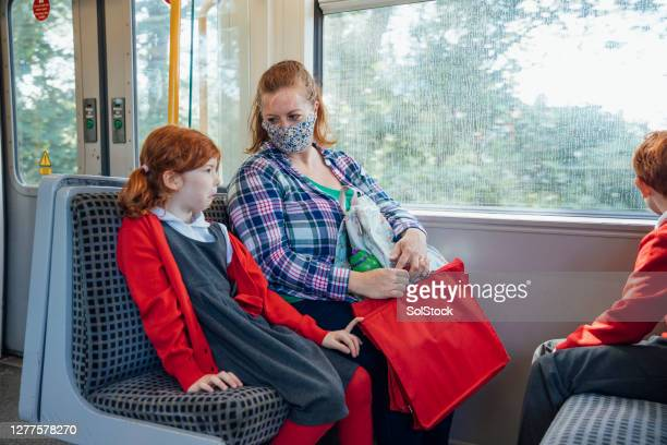 taking the train to station - train interior stock pictures, royalty-free photos & images