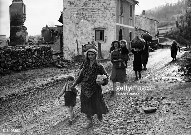 Taking their children with them Italian women evacuate their village during World War II
