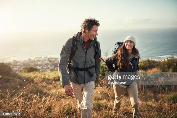 taking their date to the top of the mountain - backpacker stock pictures, royalty-free photos & images