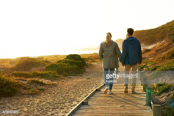taking their journey together - mid adult couple stock pictures, royalty-free photos & images