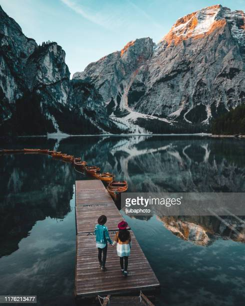 taking their love outside - pragser wildsee stock pictures, royalty-free photos & images